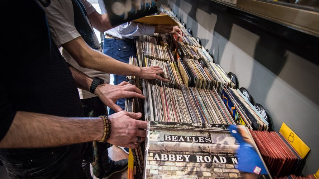 hands searching for records